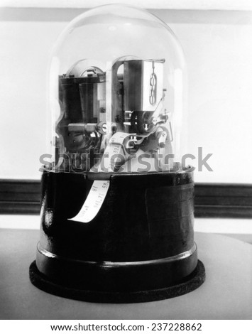 Classic 1920's stock ticker with a glass dome Stock tickers were specialized telegraphs that conveying stock prices Ca.