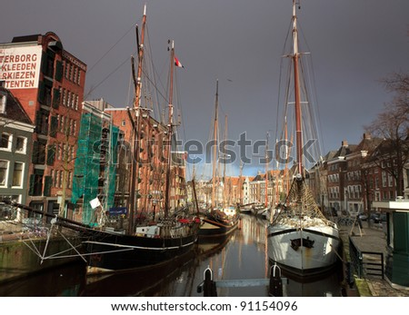 Classic sailing ships at a sailing event in an old harbor in Holland. - stock photo