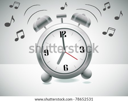 Classic silver alarm clock with bells on top ringing - stock photo