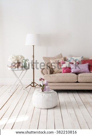 classic sofa and decorative lamps behind white wall interior decor - stock photo