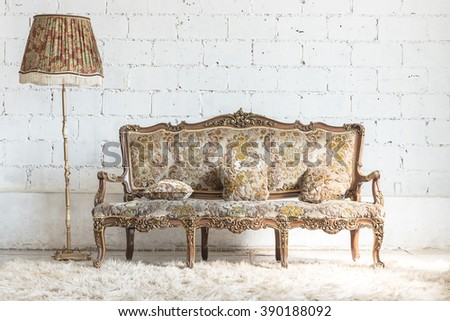 classic sofa style and lamp in vintage room with white wall - stock photo