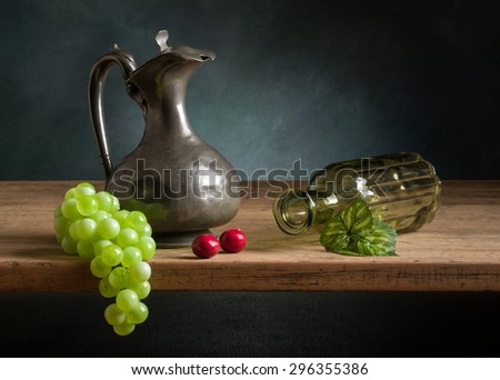 Classic still life with fruit and jug. - stock photo