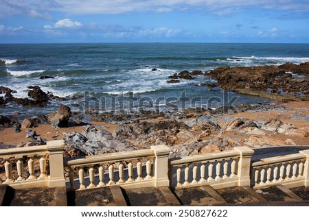 Classic style balustrade and Atlantic Ocean coast in Foz district of Porto in Portugal. - stock photo