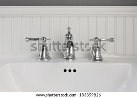 Classic style bathroom interior with white sink, painted wall.  - stock photo