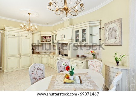 Classic style kitchen and dining room interior in beige pastoral colors - stock photo