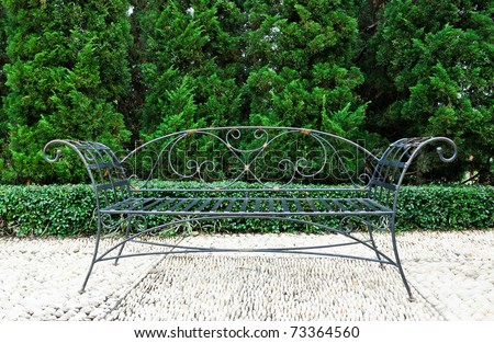 Classic style of black metal sofa in the Spanish garden. - stock photo