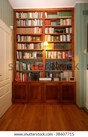 Classic style wooden bookshelf with a range of interesting books - stock photo