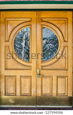 Classic style wooden door with windows - stock photo