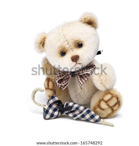 Classic teddy bear gentleman with umbrella - stock photo