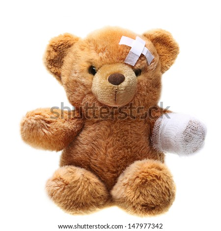 Classic teddy bear with bandages isolated on white background - stock photo