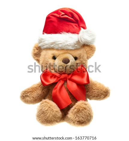 Classic teddy bear with red bow and Santa hat isolated on white background