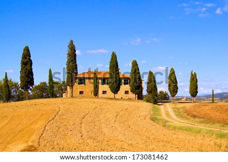 Classic Tuscany landscape with stone house and row of cypress trees, Italy - stock photo