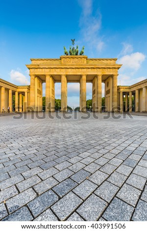 Classic vertical view of famous Brandenburger Tor (Brandenburg Gate), one of the best-known landmarks and national symbols of Germany, in beautiful golden morning light at sunrise, Berlin, Germany - stock photo