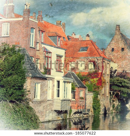 Classic view of channels of Bruges. - stock photo