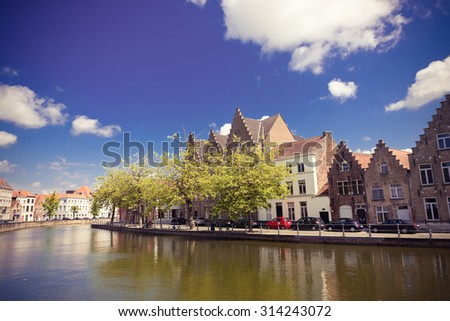 Classic view of channels of Bruges. Belgium. Medieval fairytale city. Summer urban landscape.. Instagram style filtred image