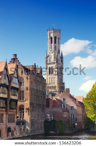 Classic view of channels of Bruges. Belgium. Medieval fairytale city.Tower Belfort in Bruges - stock photo