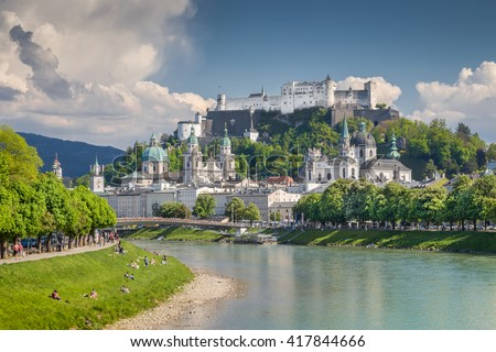 Classic view of the famous historic city of Salzburg with Hohensalzburg Fortress and Salzach river on a sunny day with blue sky and clouds in springtime, Salzburger Land, Austria - stock photo