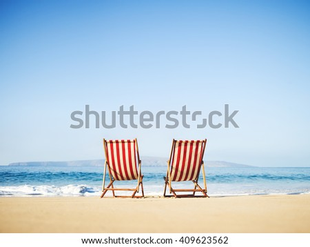 Classic vintage beach chairs on sunny tropical beach