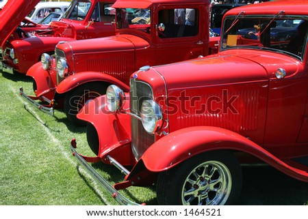 Classic Vintage Red Pickup Trucks in a Row - stock photo