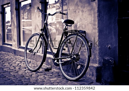 Classic vintage retro city bicycle in Copenhagen, Denmark - stock photo