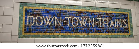 Classic vintage subway directions in Manhattan, New York City. Downtown Trains. - stock photo