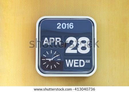 Classic wall clock on the wood background. - stock photo