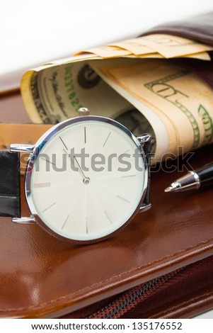 Classic Watches, pen, money (dollar) on brown wallet. - stock photo