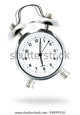 Classic white alarm clock ringing at six o'clock, isolated against a white background - stock photo