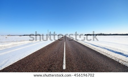 Classic winter scene of a highway in rural area. Latvia