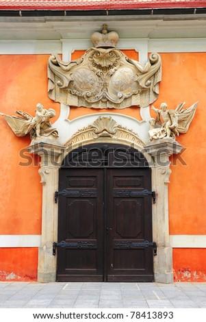 Classic wooden door, Cesky Krumlov - stock photo