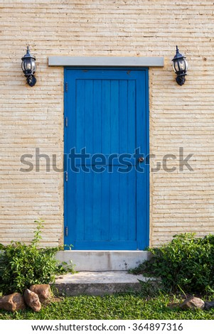 Classic wooden door with flower on the wall