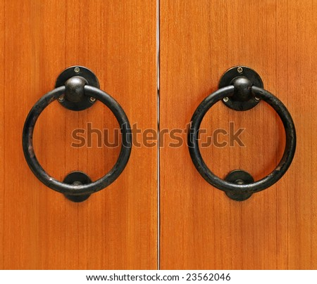 classic wooden door with handle - stock photo