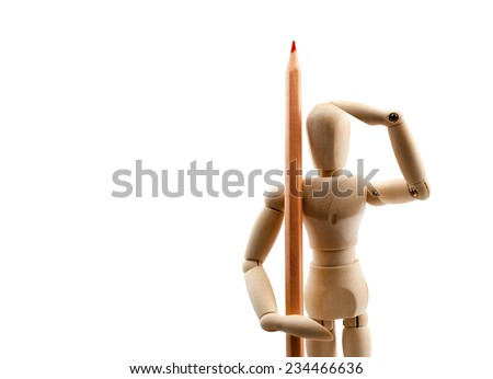 Classic wooden dummy holds red pencil like a soldier, isolated on white. - stock photo