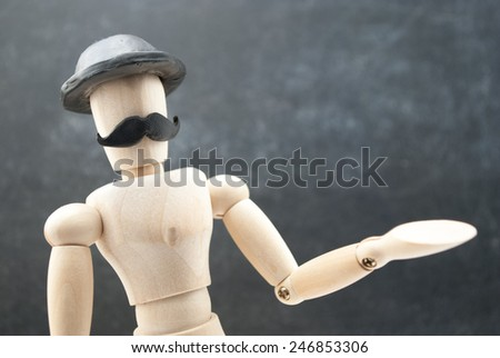 Classic wooden dummy with black mustache and black hat. - stock photo