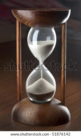 Classic wooden sand clock, on dark background - stock photo