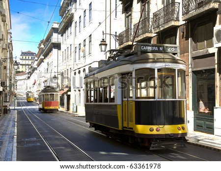 Classic yellow trams (electrics) in downtown Lisbon, Bairro alto, Alfama, Portugal - stock photo