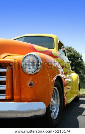 Classic Yellow Truck with Orange Flames - stock photo