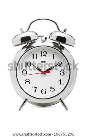 classical alarm clock on white background - stock photo