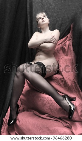 Classical artistic style picture of a woman dressed in black nylons. - stock photo