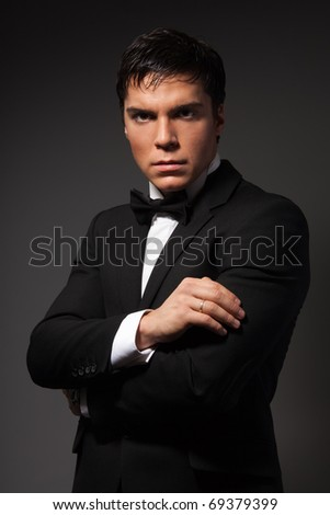 Classical business male portrait of mature man in formal suit, looking at camera