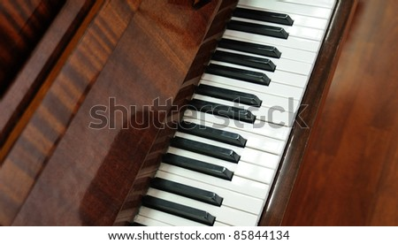 Classical closeup of grand piano keys - stock photo