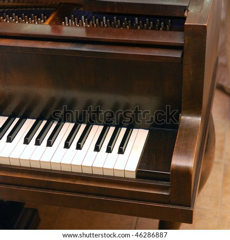 Classical grand piano keyboard closeup - stock photo