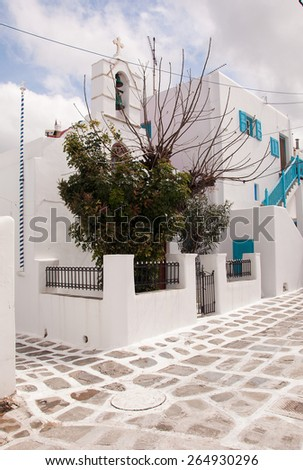 Classical Greek church in the town with trees... - stock photo