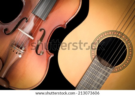 Classical Guitar and Violin, isolated on Black - stock photo