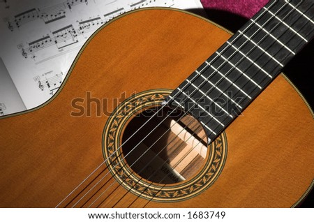 Classical guitar detail under spotlight - stock photo