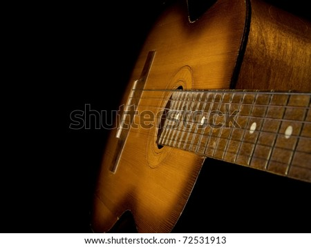 classical guitar isolated on black background - stock photo