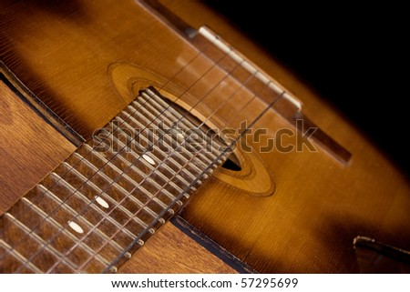 classical guitar on black background