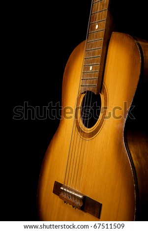 classical guitar on black background - stock photo