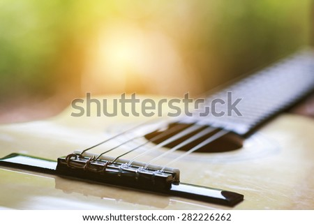 Classical guitar on the window