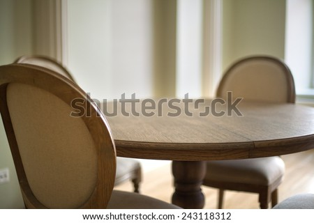 Classical interior of a dining table and chairs - stock photo